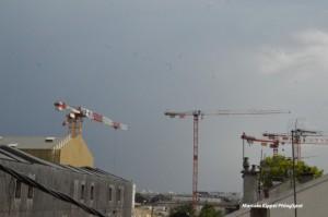 The Cranes under grey sky